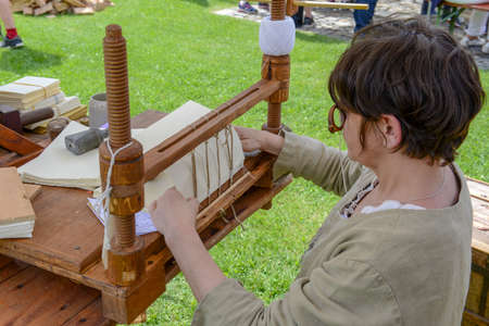 Bellinzona, Switzerland - 27 May 2018: bookbinder at the medieval market on Castelgrande castle at Bellinzona on the Swiss alps Editorial