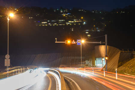The car light trails in front of a tunnel at Lugano on Switzerland