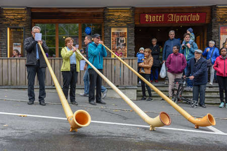 Engelberg, Switzerland - 29 September 2018: Music with alphorn at the annual transhumance at Engelberg on the Swiss alps