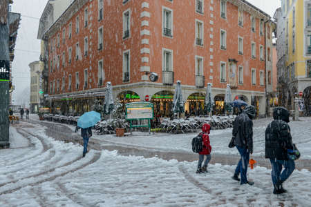 Lugano, Switzerland - 5 March 2016 - people walking on the old part of Lugano in Switzerland with snow Sajtókép