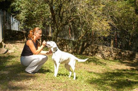 Lugano, Switzerland - 11 November 2002: girl with a dog at the animal shelter of Lugano on Switzerland