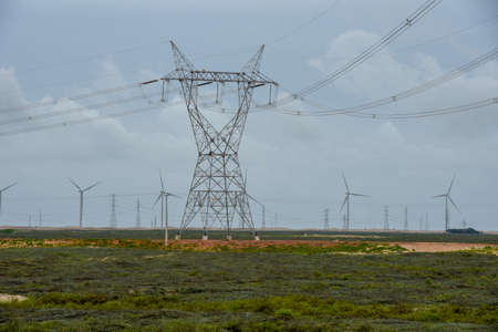 Windmills and electric trellis on a field near Atins on Brazil Reklamní fotografie