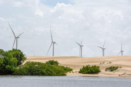 Windmills on the sand dunes of Lencois Maranhenses near Atins on Brazil