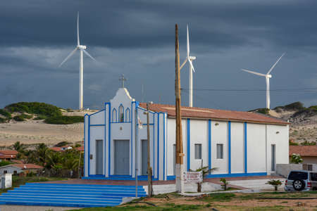 Church in front of Wind farm at Canoa Quebrada on Brazil Editoriali