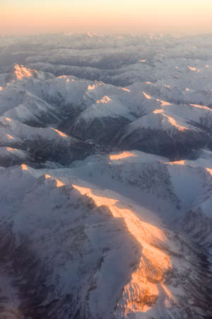 Aerial winter sunset view of the Alps