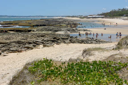 Sibauma, Brazil - 23 January 2019: people in the natural pool at Sibauma near Pipa on Brazil