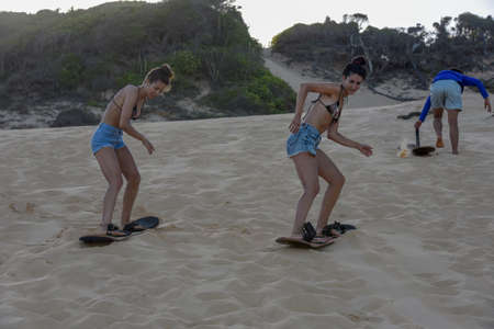 Pipa, Brazil - 23 January 2019: Tourists Sandboarding on a dune near Pipa on Brazil Editorial