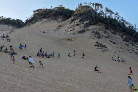 Pipa, Brazil - 23 January 2019: Tourists Sandboarding on a dune near Pipa on Brazil Editorial