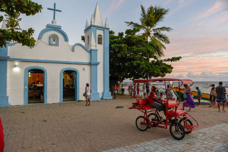 Praia do Forte, Brazil - 31 January 2019: people visiting the colonial church of mainly square in the Praia do Forte on Brazil