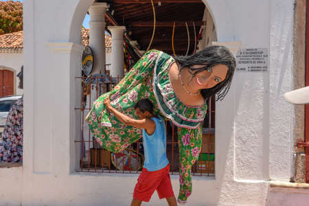 Olinda, Brazil - 27 January 2019: man carrying a carnival puppet at Olinda on Brazil