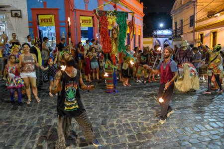 Olinda, Brazil - 26 January 2019: people parade in the streets during the carnival of Olinda on Brazil