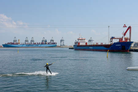 Aarhus, Denmark - 19 June 2019: man wakeboarding on the port of Aarhus in Denmark