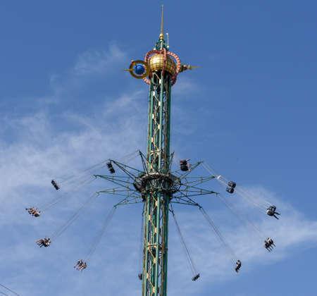 Swinging fair ride on Tivoli amusement park at Copenhagen on Denmark 免版税图像