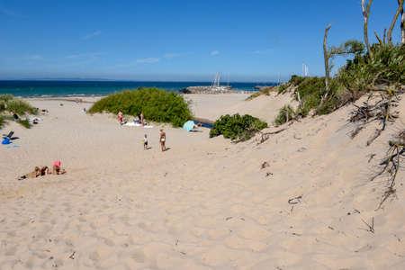 Hornbaek, Denmark - 28 June 2019: people sunbathing on the beach of Hornbaek in Denmark