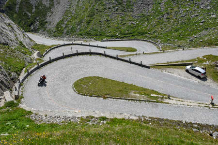 Motorcyclist along the old road of Mount Gotthard in the Swiss alps