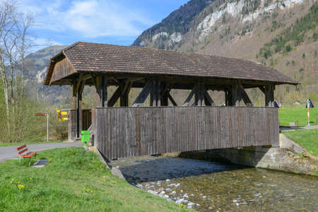 Old covered wooden bridge at Wolfenschiessen on the Swiss alps