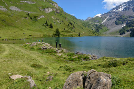 Engstlenalp, Switzerland - 4 August 2019: people fishing on lake Engstlen over Engelberg on the Swiss alps