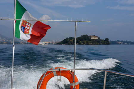 Boat leaving Madre island on lake Maggiore in Italy