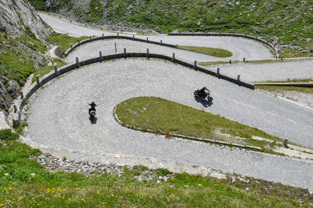 Mount Gotthard, Switzerland - 3 August 2019: motorcyclists along the old road of Mount Gotthard on the Swiss alps Redactioneel