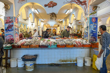 Sousse, Tunisia -  7 November 2019: people selling fish at the market on the medina of Sousse in Tunisia