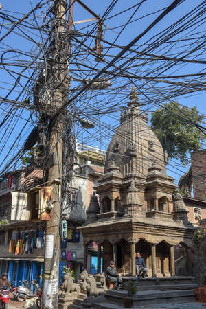Patan, Nepal - 24 January 2020: multitude of electric cables suspended in the street of Patan near Kathmandu on Nepal Editorial