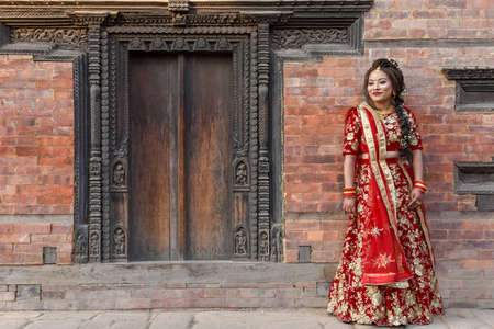 Bhaktapur, Nepal - 27 January 2020: beautiful bride with traditional clothes at Bhaktapur on Nepal