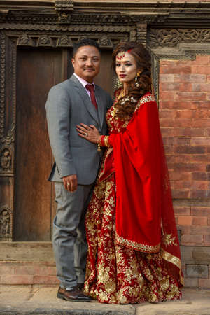 Bhaktapur, Nepal - 27 January 2020: wedding couple with traditional clothes at Bhaktapur on Nepal