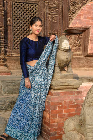 Bhaktapur, Nepal - 28 January 2020: beautiful woman with traditional clothes at Bhaktapur on Nepal