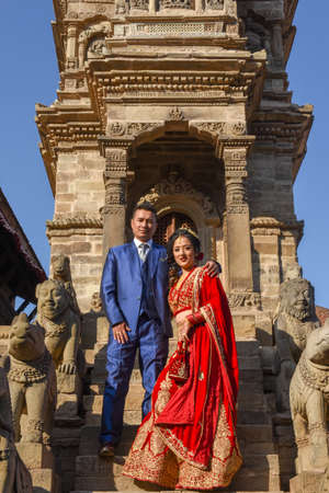 Bhaktapur, Nepal - 28 January 2020: wedding couple with traditional clothes at Bhaktapur on Nepal