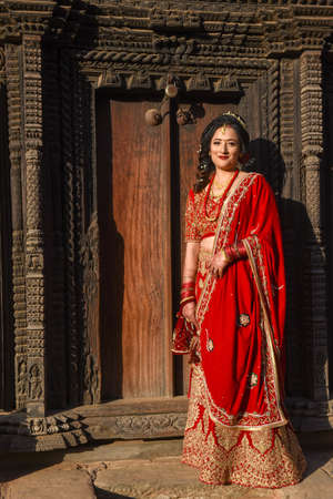Bhaktapur, Nepal - 28 January 2020: beautiful bride with traditional clothes at Bhaktapur on Nepal
