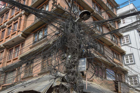 Multitude of entangled electrical cables at Kathmandu on Nepal