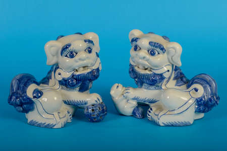 Chinese lion dogs statue on blue background Imagens