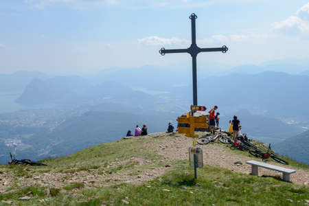 Capriasca, Switzerland - 2 June 2020: people at cross of Motto on Capriasca velley over Lugano in Switzerland