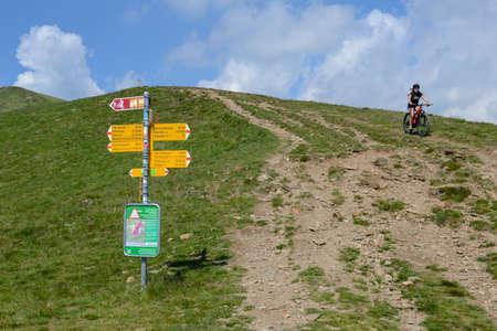 Capriasca, Switzerland - 2 June 2020: mountain bikers at Motto della croce on Capriasca velley in Switzerland