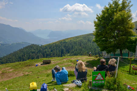 Capriasca, Switzerland - 2 June 2020: people eating on a restaurant on Capriasca valley over Lugano on Switzerland