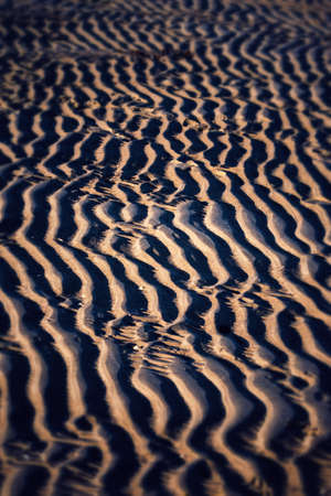 lucidity: sand Wave Stock Photo