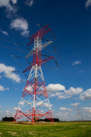 high voltage pylons against the background of blue sky
