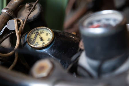 headlamp and speedometer of an old motorcycle. Blurry foreground
