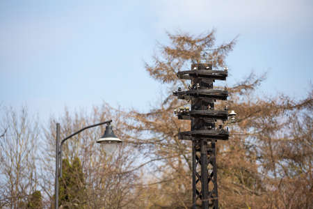 Obsolete electricity poles on a sunny day Stock fotó