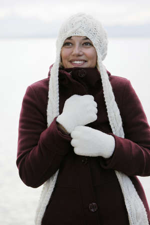 Outdoor shot of a young, pretty woman with a white wool cap Stock Photo - 8490329