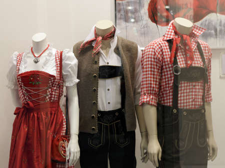 Germany, Munich - July 31, 2010: Bavarian display dummies with traditional clothes Editorial