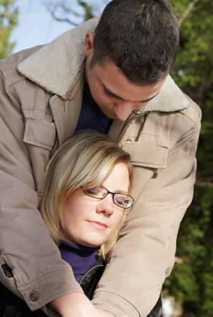 familiar: Outdoor shot of two young people as a familiar couple in love Stock Photo