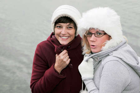 young women in winter clothing, friendly smiling Stock Photo - 8572682
