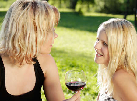 Women in conversation outdoors in the countryside Stock Photo - 8572678
