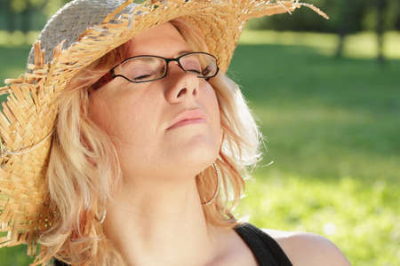 Young woman sleeping with sun hat, summer outdoor shot photo