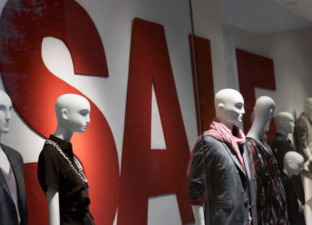 Germany, Munich - July 31, 2010: Display dummies in the summer sales and text Sale. Editorial