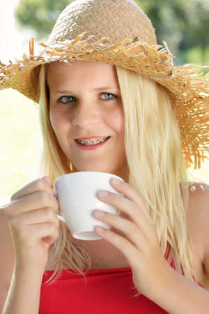 happy girl with tea cup and braces photo