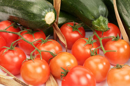 Tomatoes and zucchini as a healthy and vegetarian still life