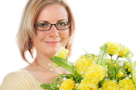 Pretty young woman in yellow shirt with yellow flowers.