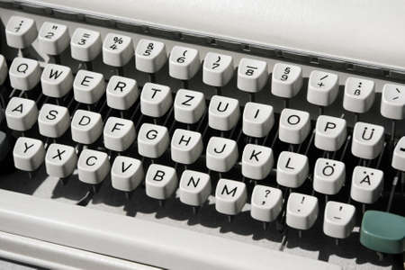 Aged mechanical typewriter, diagonal image formation.